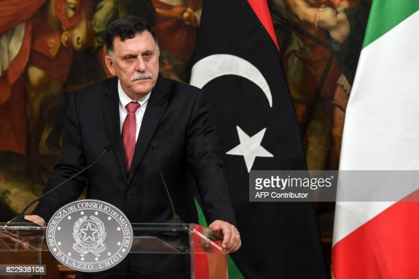 Libya's UN-backed Prime Minister Fayez al-Sarraj looks on during a joint press conference with Italian Prime Minister following their meeting at...