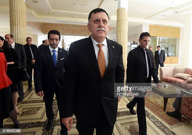 Libya's unity government's Prime Ministerdesignate Fayez alSarraj arrives for the 8th ministerial meeting of Libya's neighbouring countries on March...
