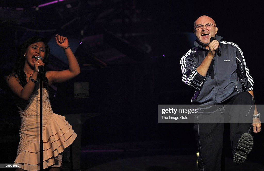 Lica de Guzman and Phil Collins perform during the Little Dreams Foundation 10th Anniversary Gala at Leman Theatre on October 21, 2010 in Geneva, Switzerland.