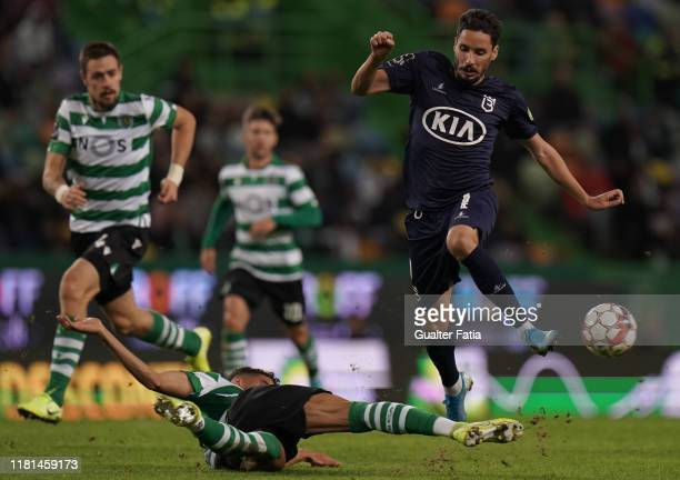 Lica of Belenenses SAD with Tiago Ilori of Sporting CP in action during the Liga NOS match between Sporting CP and Belenenses SAD at Estadio Jose...