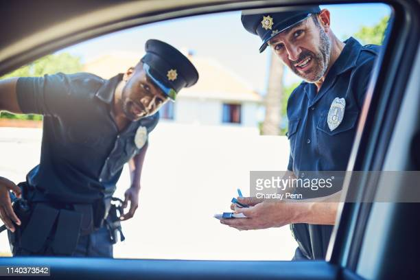 license and registration please - police car stock pictures, royalty-free photos & images