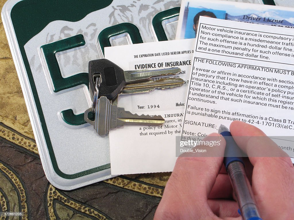License Plate, Keys, and Papers Proving Evidence of Auto Insurance : Stock Photo