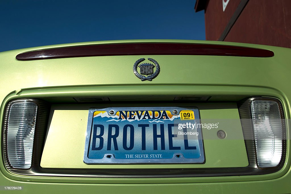 A license plate reading 'Brothel' is displayed outside Wild West Saloon & Brothel in Winnemucca, Nevada, U.S., on Wednesday, Aug. 21, 2013. Growing use of the Internet to arrange liaisons with prostitutes and decreased patronage by truckers squeezed by rising fuel costs are also hurting houses of prostitution that took root during Nevada's mid-1800s silver-mining boom, George Flint, lobbyist for the Nevada Brothel Owners Association and brothel managers say. Photographer: David Paul Morris/Bloomberg via Getty Images