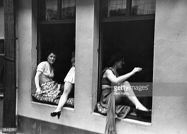 Licensed street prostitutes barter with customers through the windows of their brothels in Hamburg Original Publication Picture Post 4854 The Two...