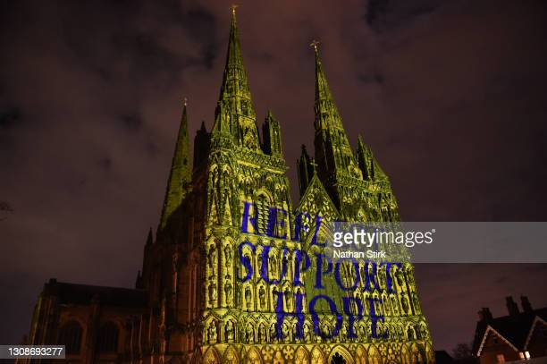 "Lichfield Cathedral is illuminated in yellow with the words ""Reflect, Support, Hope"" on National Day of Reflection on March 23, 2021 in Lichfield,..."