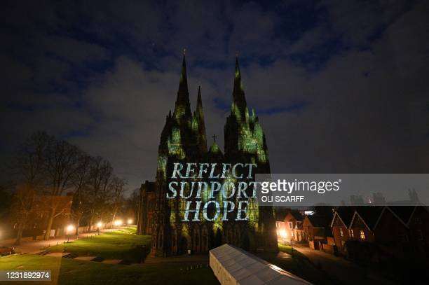 Lichfield Cathedral is illuminated with the words 'Reflect', 'Support', and 'Hope', as part of the National Day of Reflection on the anniversary of...