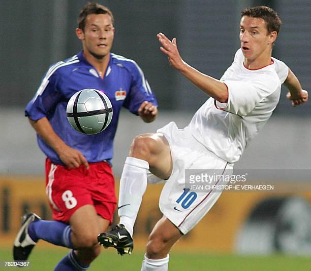 Lichtenstein's Ronny Buchel vies with Slovakia's Marek Mintal during their World Cup 2006 qualifying football match 17 August 2004 at the Rheinpark...