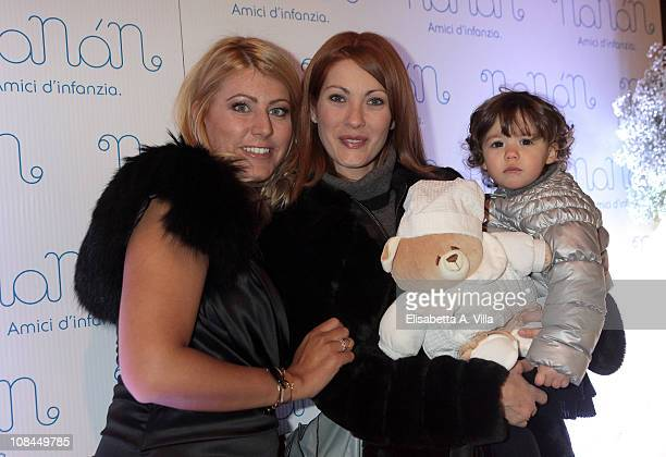 Licia Angeli poses with Milena Miconi and her daughter Agnese during the Nanan Flagship Store Opening on January 27 2011 in Rome Italy