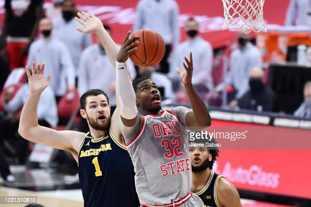 Liddell of the Ohio State Buckeyes attempts to score on Hunter Dickinson of the Michigan Wolverines in the first half at Value City Arena on February...