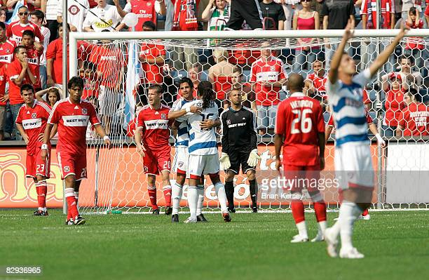 Lider Marmol Wilman Conde Brian McBride goalkeeper Jon Busch and Andy Herron of the Chicago Fire walk away as Marcelo Saragosa Adrian Serioux and...