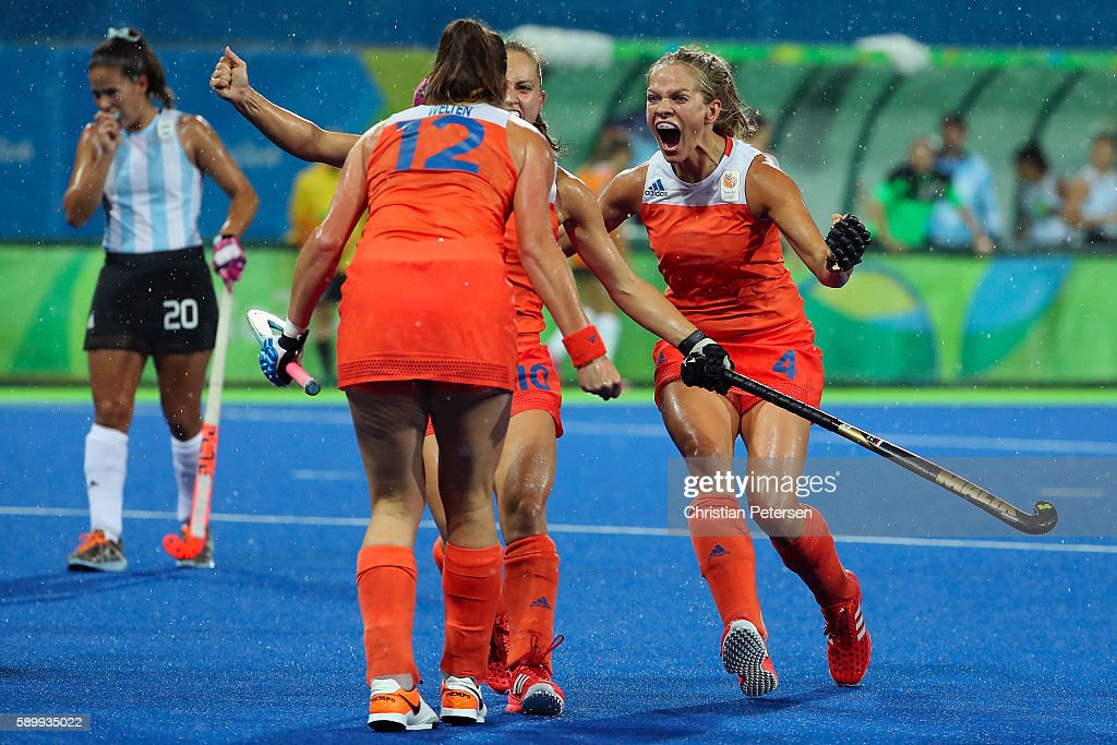 Lidewij Welten #12, Kelly Jonker #10 and Kitty van Male #4 of Netherlands celebrate after Welten scored a first half goal against Argentina during the quarter final hockey game on Day 10 of the Rio 2016 Olympic Games at the Olympic Hockey Centre on August 15, 2016 in Rio de Janeiro, Brazil.
