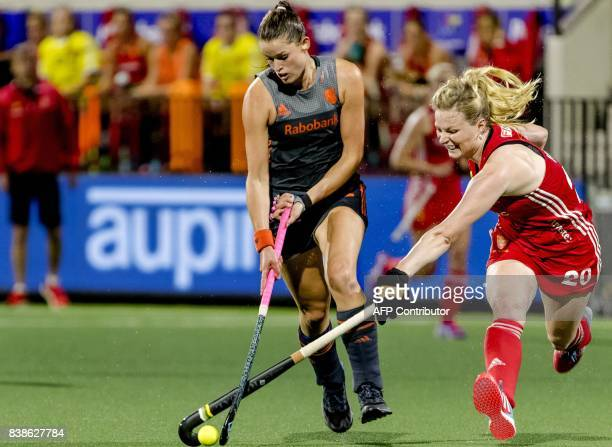 Lidewij Welten of The Netherlands fights for the ball with Hollie Web of England during the women's EuroHockey Championships match between the...