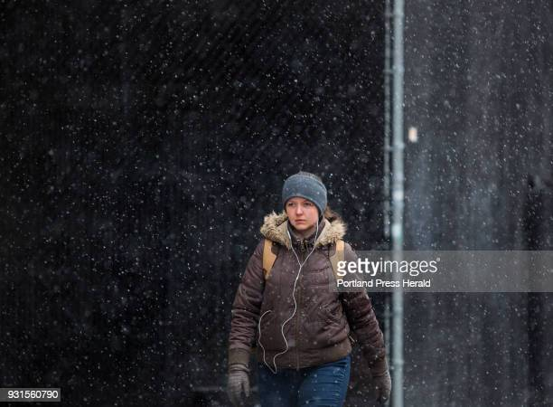 Lidia Mather walks along Federal Street in Portland on her way to work on Tuesday Mach 13 2018