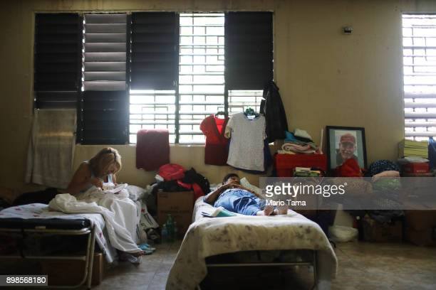 Lidia Sellas and her daughter Sheila Martinez who is blind rest in the shelter for Hurricane Maria victims where they currently reside on Christmas...