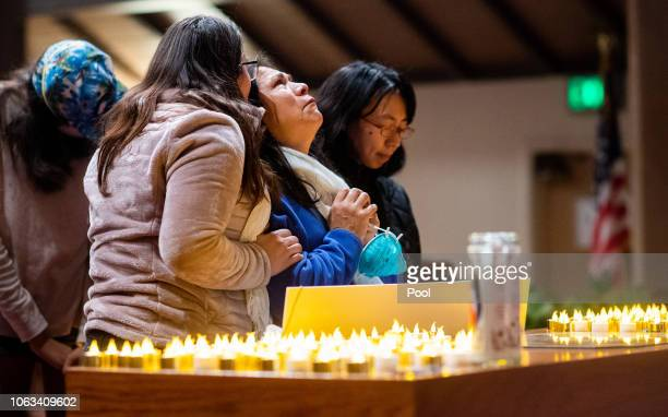 Lidia Steineman who lost her home in the Camp Fire prays during a vigil for fire victims at the First Christian Church of Chico on November 18 2018...