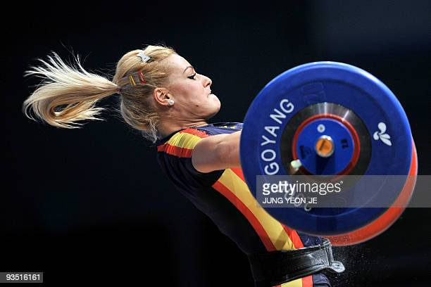 Lidia Valentin of Spain attempts a lift in the snatch of the women's 75kg category event at the World Weightlifting Championships in Goyang, north of...