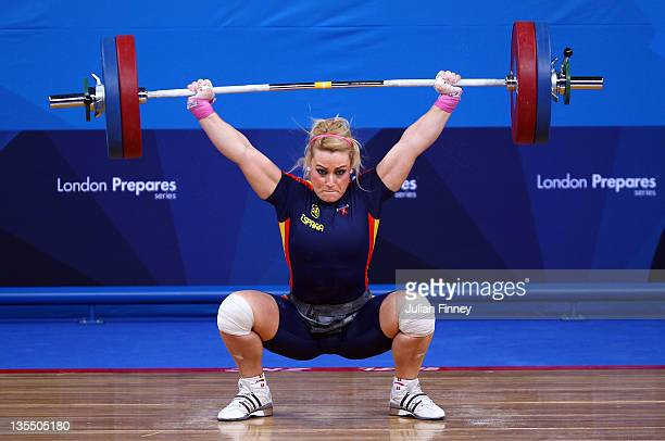 Lidia Valentin of Spain makes a lift in the Women's 75kg during the Weightlifting LOCOG Test Event for London 2012 at ExCel on December 11 2011 in...