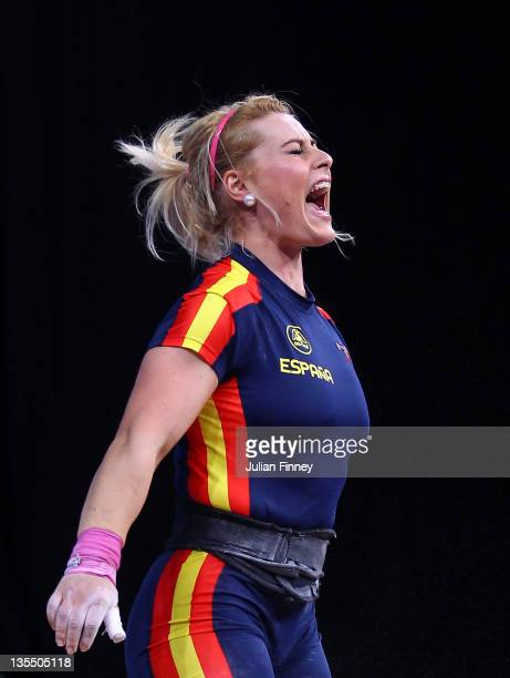 Lidia Valentin of Spain reacts in the Women's 75kg during the Weightlifting LOCOG Test Event for London 2012 at ExCel on December 11 2011 in London...