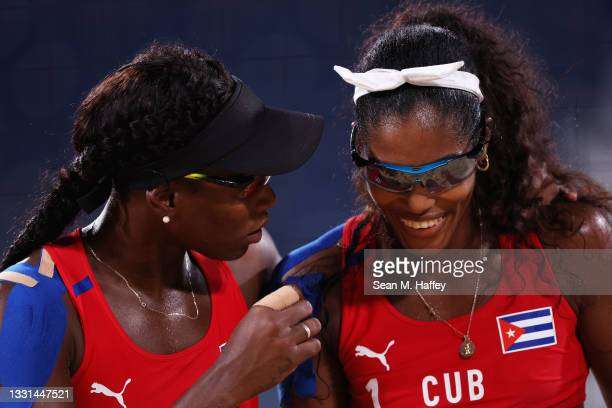 Lidianny Echevarria Benitez and Leila Consuelo Martinez Ortega of Team Cuba reacts as they compete against Team Italy during the Women's Preliminary...