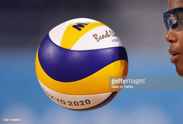 Lidianny Echevarria Benitez of Team Cuba prepares to serve against Team Italy during the Women's Preliminary - Pool E beach volleyball on day seven...