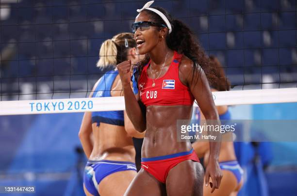 Lidianny Echevarria Benitez of Team Cuba reacts as she competes against Team Italy during the Women's Preliminary - Pool E beach volleyball on day...