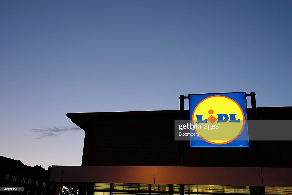 A Lidl Logo Sits Illuminated On A Sign Outside A Lidl Discount