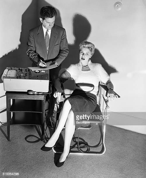 6/4/1954 Lie detector being demonstrated by Dr Fred Inbau professor of criminal law at Northwestern University Photo shows Dr Inbau giving the test...