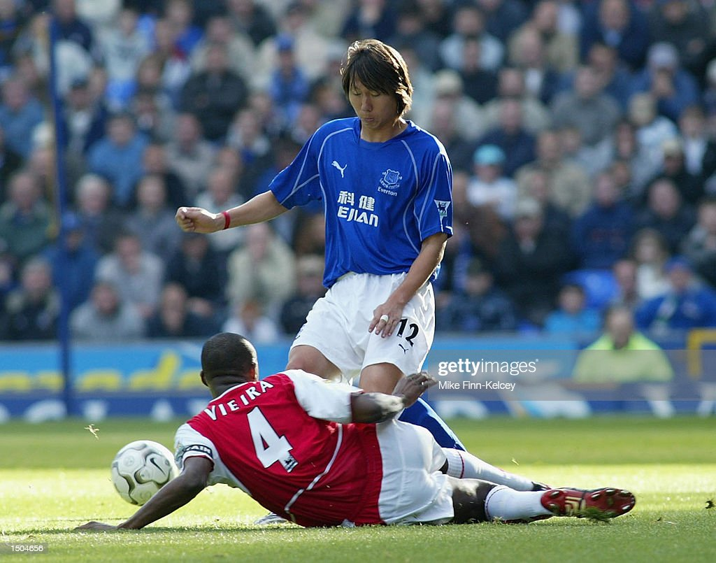 Lie Tie of Everton takes the ball past Patrick Vieira of Arsenal during the FA Barclaycard Premiership match between Everton and Arsenal at Goodison Park in Liverpool on October 19, 2002.