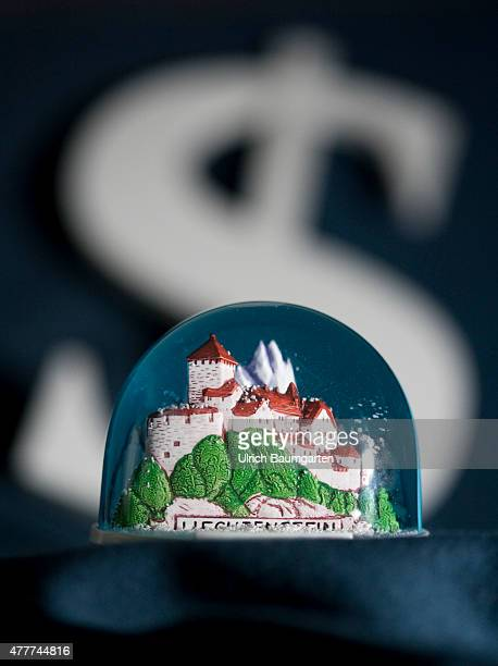 Liechtenstein back on the blacklist of tax havens Our picture shows a snowglobe with the princely castle in Vaduz In the background the dollar symbol