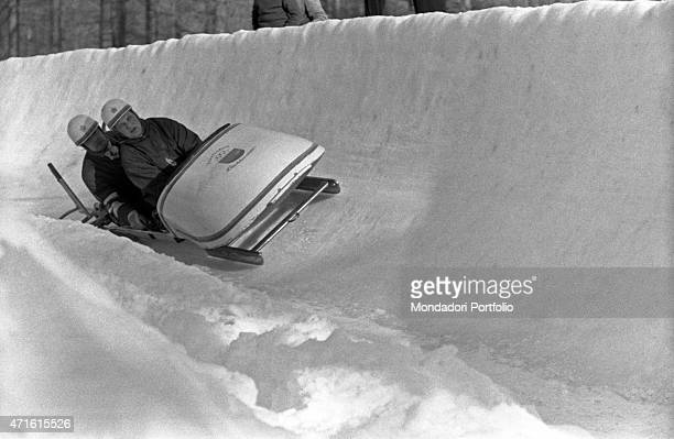 Liechtensteiner bobsleigh team competing in a race at the VII Olympic Winter Games Cortina d'Ampezzo 1956