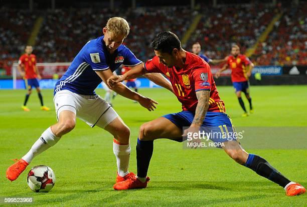 Liechtenstein's defender Martin Rechsteiner vies with Spain's midfielder Vitolo during the WC 2018 football qualification match between Spain and...