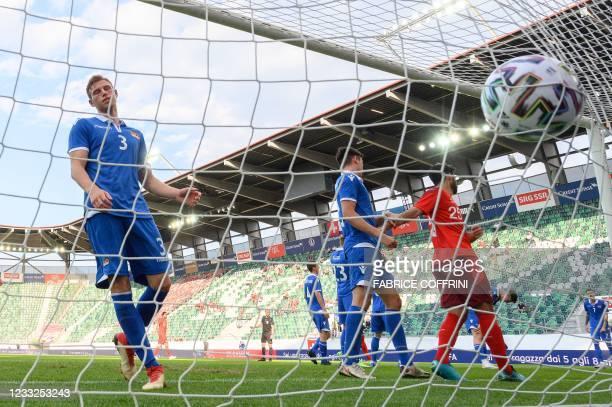 Liechtenstein's defender Maximilian Goppel reacts as his team concedes a third goal during a friendly football match between Switzerland and...