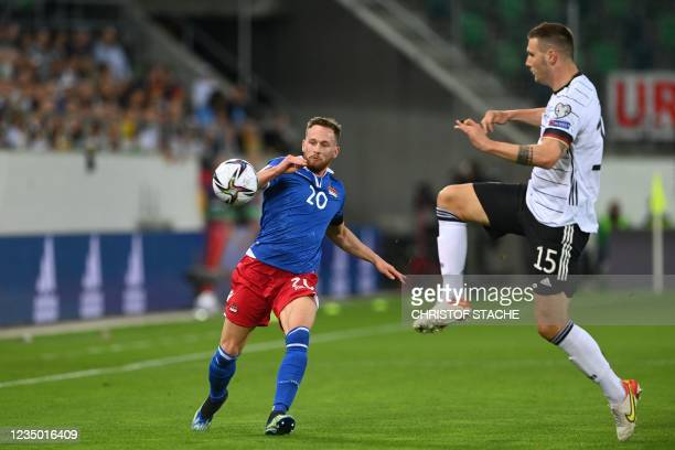 Liechtenstein's defender Sandro Wolfinger and Germany's defender Niklas Suele vie for the ball during the FIFA World Cup Qatar 2022 qualification...
