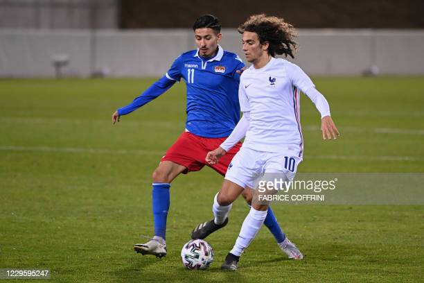 Liechtenstein's forward Menderes Caglar vies for the ball with and France's midfielder Matteo Guendouzi during the 2021 U21 European Championships...