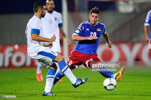 Liechtenstein's midfielder Sandro Wieser vies with Greece's midfielder Giannis Maniatis during the world cup 2014 qualifying football match...