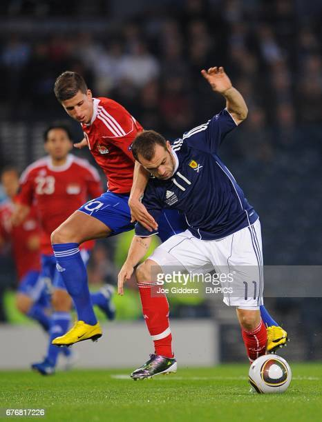Liechtenstein's Sandro Wieser and Scotland's James McFadden battle for the ball