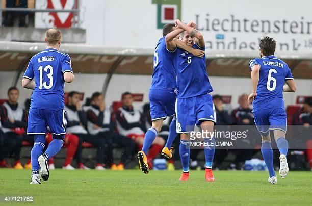 Liechtenstein's Sandro Wieser celebrate the 10 with Seyhan Yildiz and Andreas Christen during the Euro 2016 qualifying football match between...