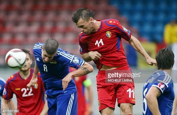 Liechtenstein's Sandro Wieser fights for the ball with Moldova's Gheorghe Boghiu during the Euro 2016 qualifying football match between Liechtenstein...