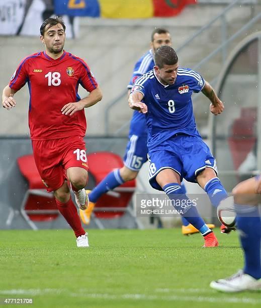 Liechtenstein's Sandro Wieser scores the 10 for his team during the Euro 2016 qualifying football match between Liechtenstein and Moldova at the...