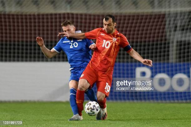 Liechtenstein's Sandro Wolfinger fights for the ball with Macedonia's Goran Pandev during the FIFA World Cup Qatar 2022 qualification football match...
