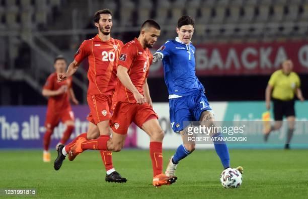 Liechtenstein's Yanik Frick vies with Macedonia's Visar Musliu during the FIFA World Cup Qatar 2022 qualification football match between North...