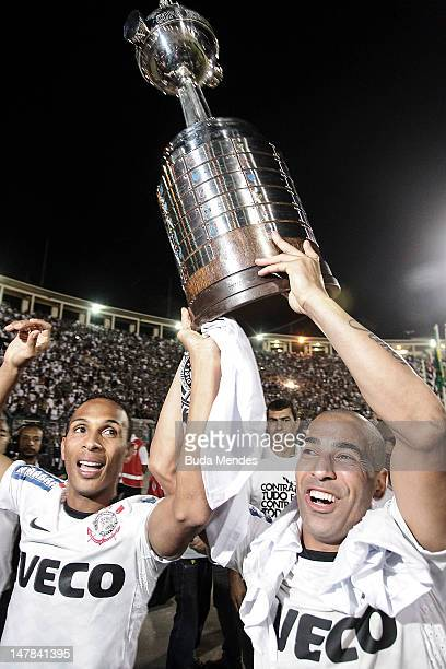 Liedson and Emerson of Corinthians, celebrate the title holding up the trophy after the second leg of the final of the Copa Libertadores 2012 between...