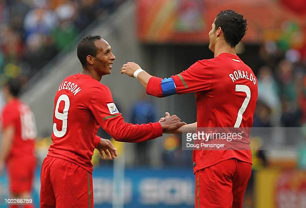 Liedson celebrates with Cristiano Ronaldo of Portugal during the 2010 FIFA World Cup South Africa Group G match between Portugal and North Korea at...
