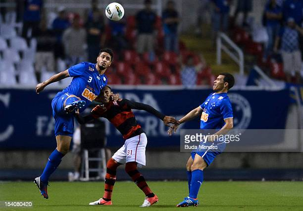 Liedson of Flamengo fights for the ball with Leo and Ceara of Cruzeiro during a match between Flamengo and Cruzeiro as part of the Brazilian Serie A...