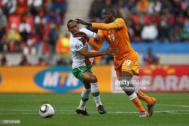Liedson of Portugal and Yaya Toure of Ivory Coast battle for the ball during the 2010 FIFA World Cup South Africa Group G match between Ivory Coast...