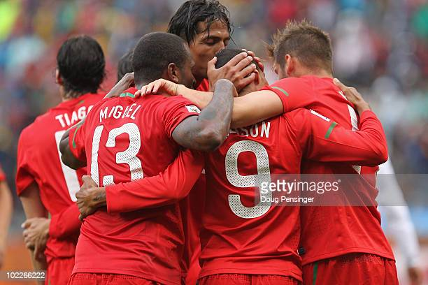 Liedson of Portugal celebrates scoring his side's fifth goal wuth team mates during the 2010 FIFA World Cup South Africa Group G match between...