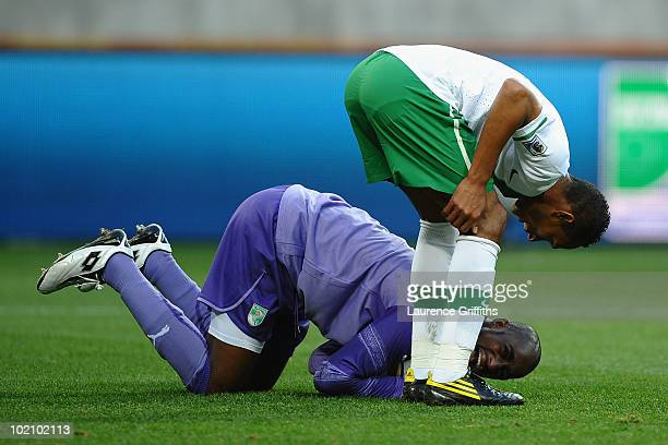 Liedson of Portugal checks on the injured Boubacar Barry of Ivory Coast during the 2010 FIFA World Cup South Africa Group G match between Ivory Coast...