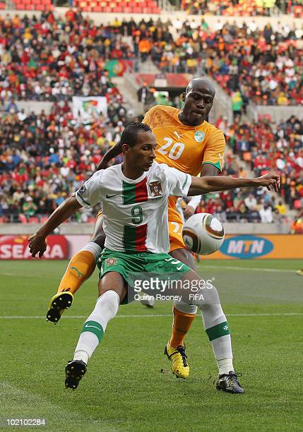 Liedson of Portugal is challenged by Guy Demel of Ivory Coast during the 2010 FIFA World Cup South Africa Group G match between Ivory Coast and...