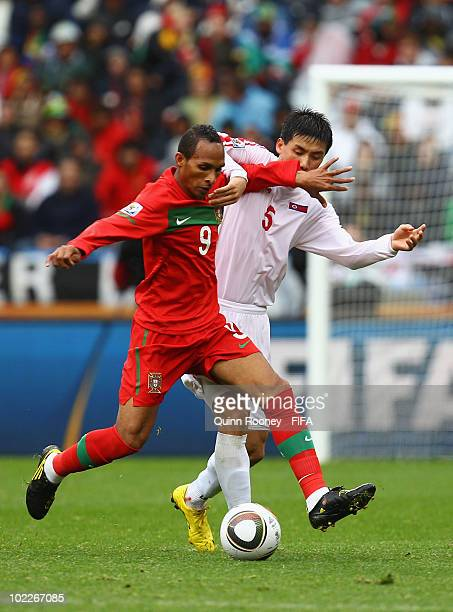 Liedson of Portugal is challenged by Ri Kwang-Chon of North Korea during the 2010 FIFA World Cup South Africa Group G match between Portugal and...