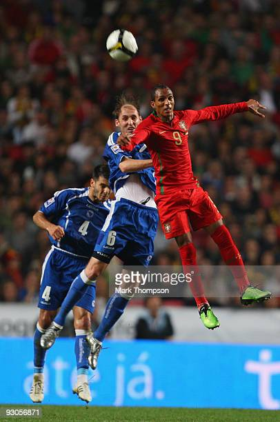 Liedson of Portugal tangles with Sanel Jahic of Bosnia during the FIFA 2010 European World Cup qualifier first leg match between Portugal and...